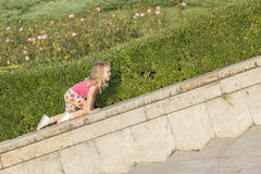 Little girl playing on parapet Royalty Free Stock Photos