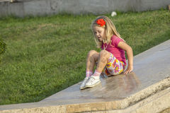 Little girl playing on parapet Royalty Free Stock Images