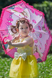 Little girl playing parasol. Free time I will take her daughter to the countryside to take pictures, record her growth process Stock Photography