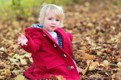 Little girl playing in the park Stock Photos