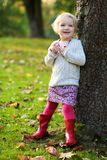 Little girl playing in the park Royalty Free Stock Images