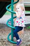 Little Girl Playing at the Park. Little Girl Playing on the Playground at the Park Stock Photos