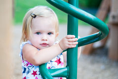 Little Girl Playing at the Park. Little Girl Playing on the Playground at the Park Stock Photography