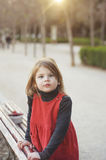 Little girl playing in the park. Portrait backlit.nding on the b Royalty Free Stock Photography