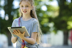Little girl playing with a PC tablet. Little blonde girl with a PC tablet Stock Image