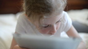Little girl playing on pc. stock video footage