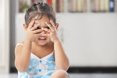 Little girl playing peekaboo Royalty Free Stock Image