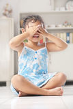 Little girl playing peekaboo or crying Royalty Free Stock Image