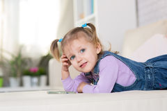 Little girl is playing with the phone Stock Photo