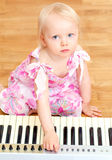 Child playing the piano Royalty Free Stock Photos