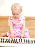 Child playing the piano Royalty Free Stock Photography