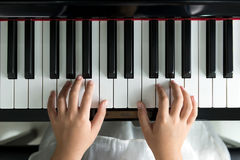 Little girl playing piano Stock Photo