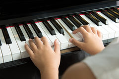 Little girl playing piano Stock Image
