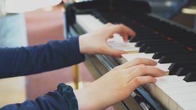 Little girl is playing piano. Little girl is playing the grand piano