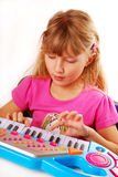 Little girl playing piano keyboard. Little girl learning to play piano keyboard Stock Photo