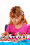 Little girl playing piano keyboard Royalty Free Stock Photos