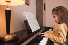 Little girl playing the piano Royalty Free Stock Image