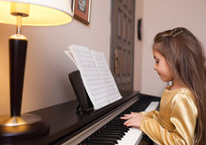Little girl playing the piano Stock Image