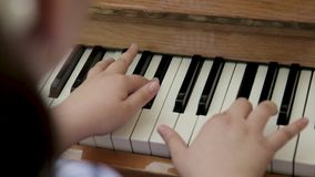 Little girl playing the piano stock footage