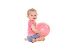 Little girl playing with pink balloon Stock Image