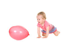 Little girl playing with pink balloon Royalty Free Stock Photos