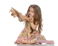 Little girl is playing with a plane Royalty Free Stock Photos