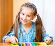 Little girl playing with plasticine. At home Royalty Free Stock Image