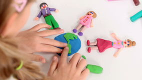 Little girl playing with plasticine stock video