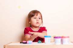 Little girl playing with plasticine. Little girl sculping with plasticine Stock Image