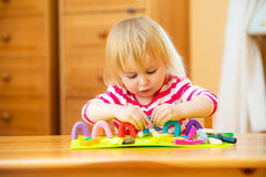 Little girl playing with plasticine Stock Photography