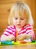 Little girl playing with plasticine Stock Photos