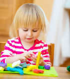Little girl playing with plasticine Stock Image