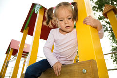 Little girl is playing in playground Royalty Free Stock Photo