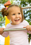 Little girl is playing in playground Stock Images