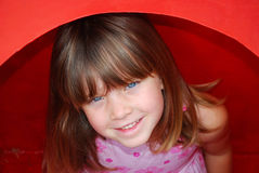 Little girl playing on playground stock photo
