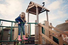 Little girl playing on playground Royalty Free Stock Photos