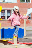 Little girl playing on the playground Stock Image