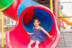 Little Girl Playing on Playground / Happy Little Girl Playing on Stock Images