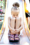 Little girl playing on a playground Stock Photos