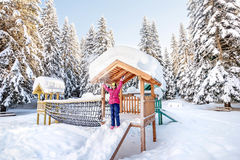Little girl playing on a playground at the National Park Durmito Royalty Free Stock Image