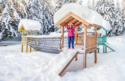 Little girl playing on a playground at the National Park Durmito Royalty Free Stock Photos