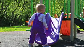 Little girl playing on the playground stock footage