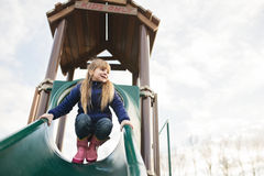 Little girl playing on playground Stock Images