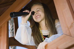 Little Girl Playing In A Playhouse Stock Photos