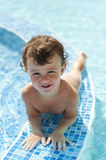 Little girl playing in the pool Royalty Free Stock Photos