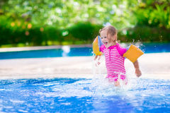 Little girl playing in a pool Stock Photography