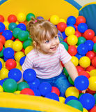 Little girl playing in the pool balls Royalty Free Stock Image