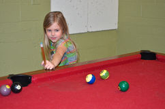 Little girl playing pool Stock Photo