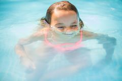 Little girl playing in pool. royalty free stock photography