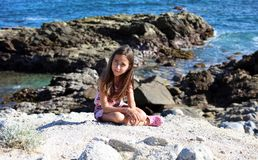 Little girl playing at ocean front in  Los Cabos Mexico resort cliff sea Stock Images